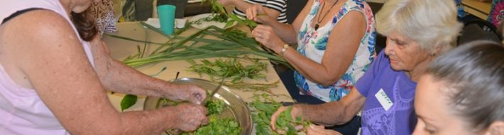 People chopping the herbs